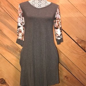 Grey dress with 3/4 length floral print sleeves.